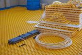Yellow underfloor heating — Stock Photo