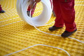 Workers installing underfloor heating system — Stock Photo