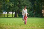 Happy family together outdoor in park — Stock Photo