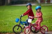 Boy and girl with bicycle — Stock Photo