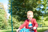 Boy on the bicycle in park — Stock Photo