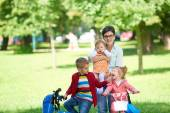 Happy young family in park — Stock Photo