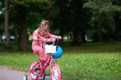 Little girl with bicycle — Stock Photo