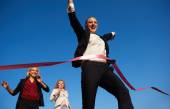 Business people running on racing track — Stock Photo