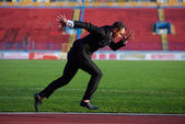 Businessman ready to sprint — Stock Photo