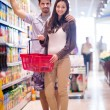 Couple shopping in a supermarket — Stock Photo #76418525