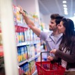 Couple shopping in a supermarket — Stock Photo #76419887