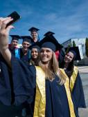Students group, graduates making selfie — Stock Photo