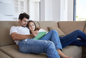 Couple at modern home using tablet computer — Stock Photo