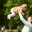 Mother and baby in park — Stock Photo #77546282