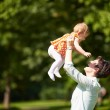 Mother and baby in park — Stock Photo #77546580
