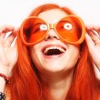 Funny redhair woman in big orange glasses — Stock Photo #62688111