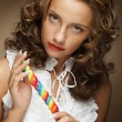 Young woman with colorful lollipop — Stock Photo #62688143