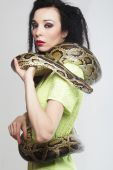 Beautiful woman with a snake — Stock Photo