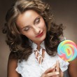 Young woman with colorful lollipop — Stock Photo #62788719