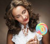 Young woman with colorful lollipop — Stock Photo