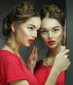 Beautiful  girl female model with bright makeup  and her reflect — Stock Photo
