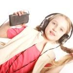 Dancing little girl headphones music singing on white background — Stock Photo #62828901