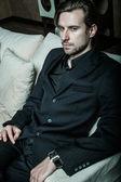 Businessman sitting on an armchair — Stock Photo