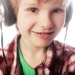 Boy is enjoy the music — Stock Photo #64400141