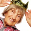 Senior woman wearing crown doing funky action — Stock Photo #65045719