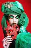 Young woman with mask — ストック写真