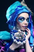 Woman with creative make up holding a bouquet of jewelry — Fotografia Stock