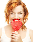 Woman with heart lolly pop — Stock Photo