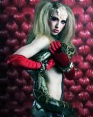 Burlesque woman holding phyton — Stock Photo