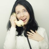 Young happy woman with vintage phone — Photo