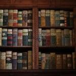 Old books on a medieval bookshelf — Stock Photo #66206319