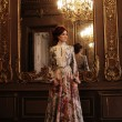 Woman standing in the palace room with mirror. — Stock Photo #66979389