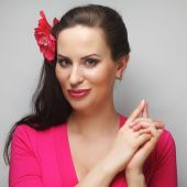 Happy woman with pink flower in the hair — Stock Photo