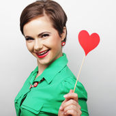 Young happy woman holding red  paper heart — Stock Photo