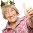 Senior woman wearing crown doing funky action — Stock Photo #67913111
