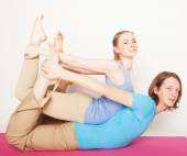 Young couple in yoga pose — Stock Photo