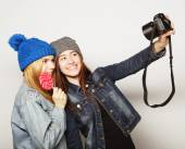 Happy girls friends taking some pictures — Stock Photo
