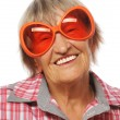 Senior happy woman wearing big sunglasses doing funky action — Stock Photo #68422527