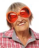 Senior happy woman wearing big sunglasses doing funky action — Stock Photo