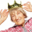 Senior woman wearing crown doing funky action — Stock Photo #68518679