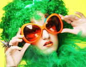 Young  woman with green hair and carnaval glasses — Stock Photo
