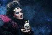 Woman with skull. Halloween theme. — Stock Photo