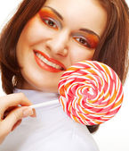 Pretty young woman holding lolly pop. — Stock Photo