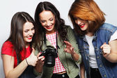 Three girls looking at camera — Stock Photo