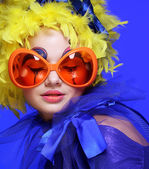 Woman with yellow  hair and carnaval glasses — Stock Photo