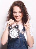 Young woman with alarmclock — Foto de Stock