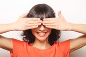 Young woman covering her eyes with her hands. — Stock Photo