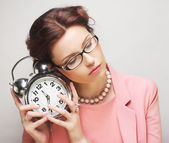 Fun businesswoman with alarmclock — Stock Photo