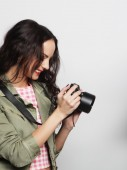 Beautiful young woman with camera — Stock Photo