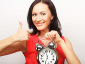 Young happy woman with alarmclock — Stock Photo